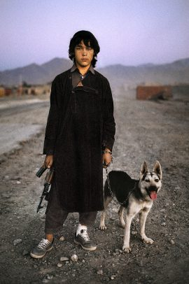Boy with dog and gun