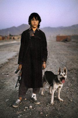 Boy with dog and gun