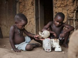 little children play with an old toy