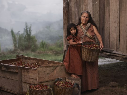 grandmother holding a basket of coffee beans and hugging her granddaughter for Lavazza Calendar 2016 by Joey L