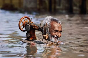 Man with sewing machine under water