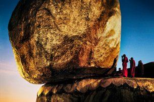 Monks praying at Golden Rock