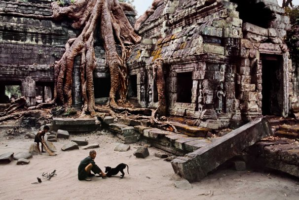 Man with dog at Ta Prohm Temple