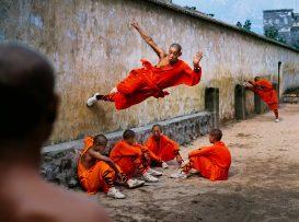 Monk running on wall