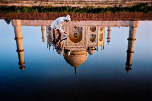 Man and taj reflection