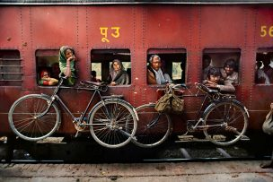 Bicycles on the side of a train in India