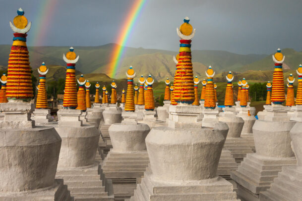 rainbow and stupas in Tibet
