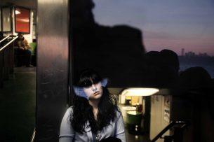 A girl inside the Staten island ferry. New York City