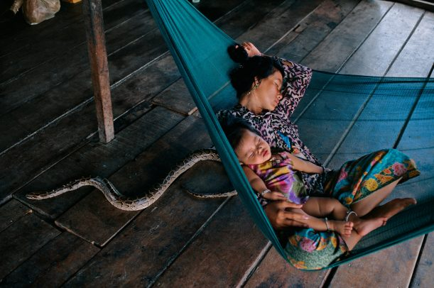 Mother and child sleeping on a hammock