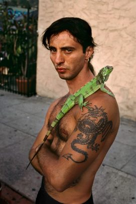 man with an iguana on his shoulder
