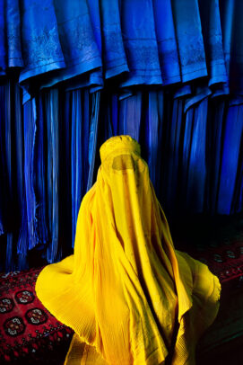 Woman in Canary Burqa on a blue background