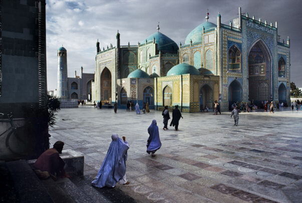 women in burqa walking in the square of Hazrat Ali Mosque