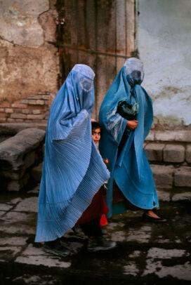 Girl Between Two Women with blue burqa in Bazaar