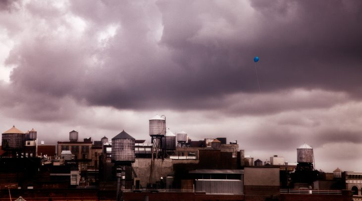 blue baloon flying over new york city
