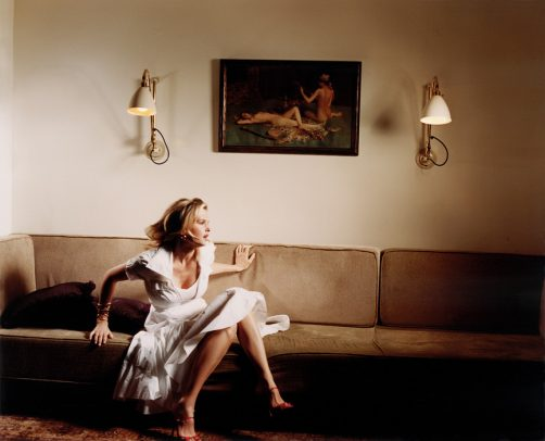 Woman in white dress on a couch