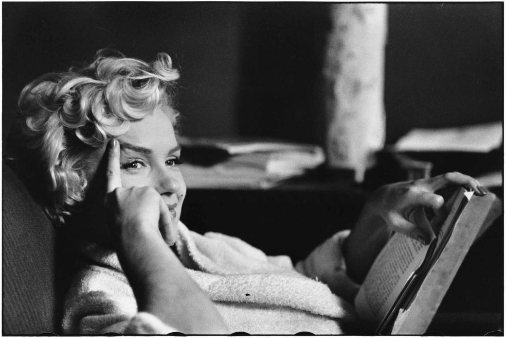 marilyn monroe reading a book by Elliott Erwitt