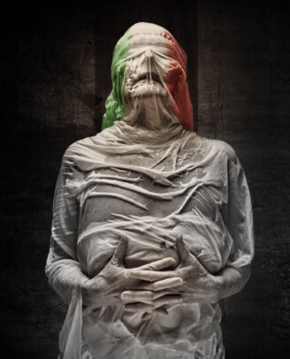 old woman wrapped in a wet woven and with the Italian flag on her head