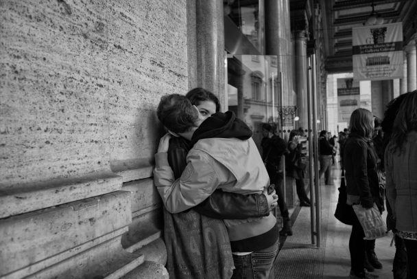 girl and boy kissing in the street