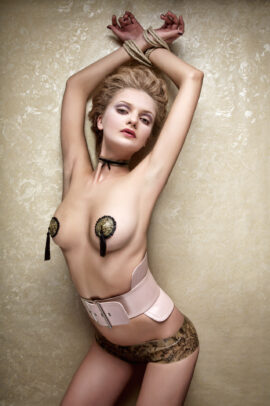 model posing with nipple covers
