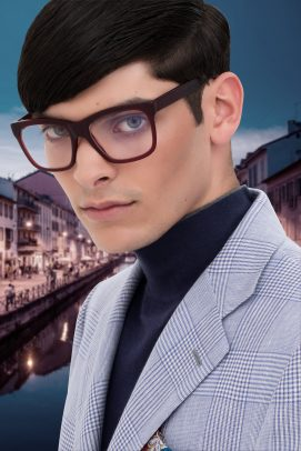 Loupe advertising man wearing black glasses with Navigli in Milan on the background