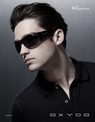 Oxydo advertising with a man wearing black sunglasses