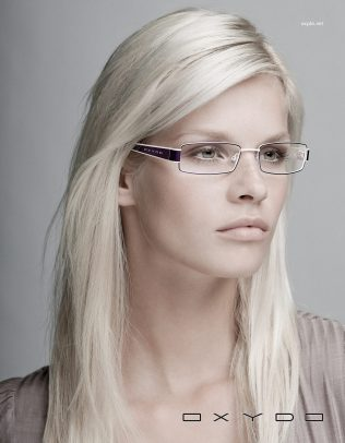 Oxydo advertising with a blonde girl wearing glasses
