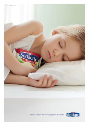Kraft Advertising with a young blonde girl sleeping in her bed