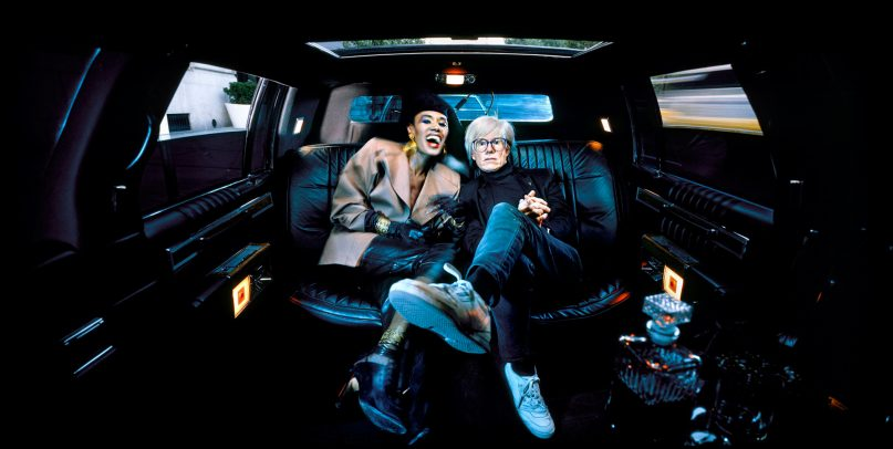 andy warhol in a limousine next to a woman