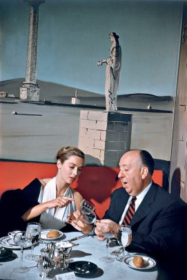 alfred hitchcock at a table