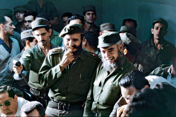 Fidel Castro smiling among his men