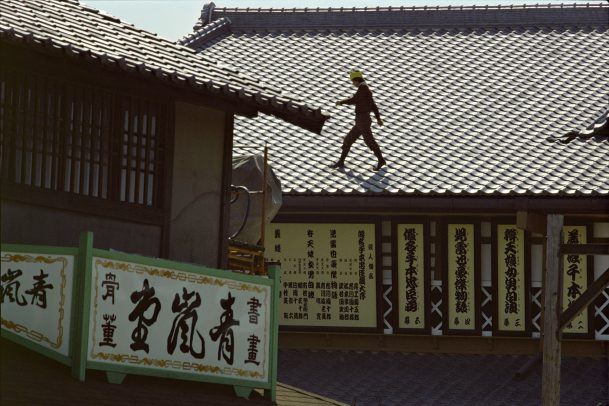 man walking on the rooftop of a building in japan