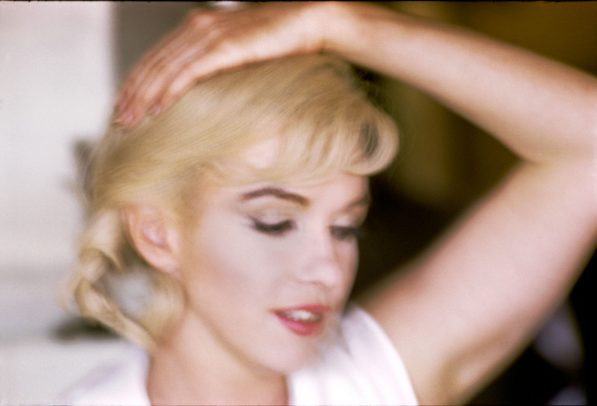 Marilyn Monroe with hand on the head