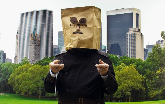 man with a sack on his head in Central Park, New York