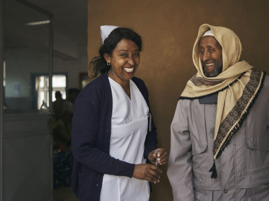 a nurse smiling and a man with veil