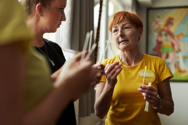 a doctor with yellow shirt and red hair during Novartis annual report by Joey L.