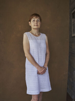 a woman with a white dress posing for Novartis annual report by Joey L.
