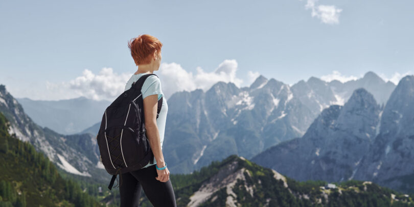the doctor watching the landscape of mountains in Slovenia during Novartis annual report by Joey L.
