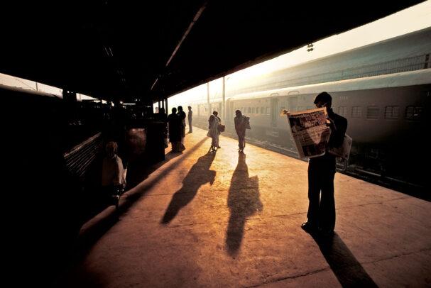 Man waiting at the train platform in Delhi