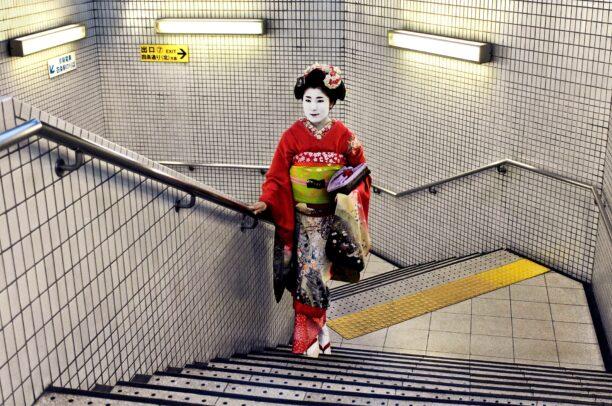 geisha with traditional kimono in subway