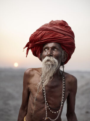 indian man with red turban and white long beard