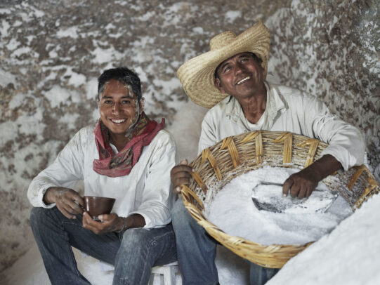 a man holding a cup of coffee and the other man holding a basket full of salt for Lavazza Calendar 2016 by Joey L