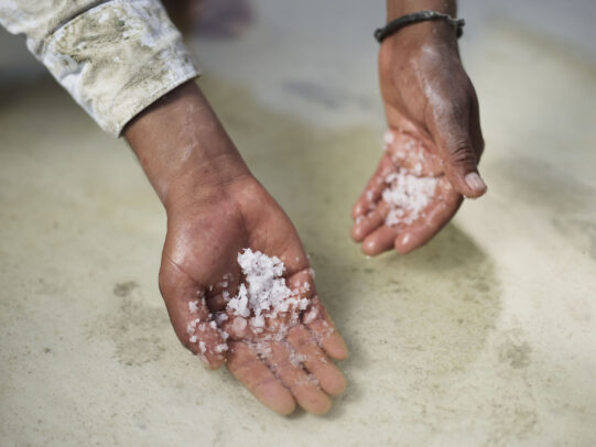 hands showing salt crystal