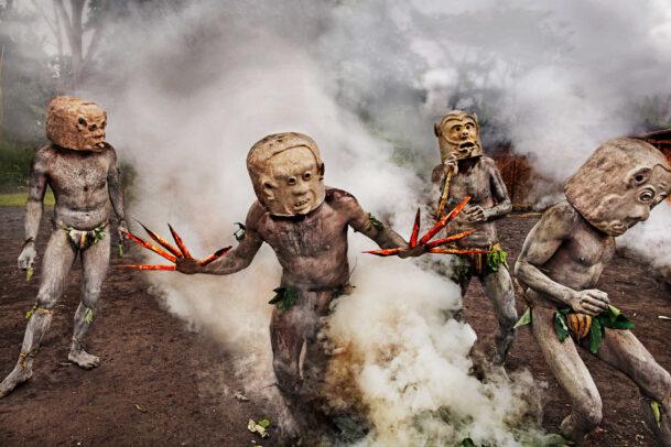 men performing ritual in papau new guinea