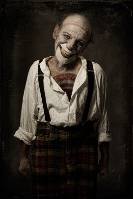 horror clown with brace smiling