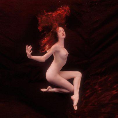redhead girl underwater