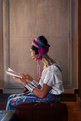 Kayan Woman Reads by a Window