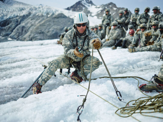 american soldier with helmet with a rope for climbing