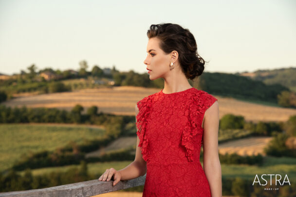 a girl with red dress and in background italian countryside for Astra Make Up by Susi Belianska