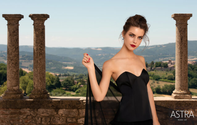 a girl with black dress in an Italian landscape