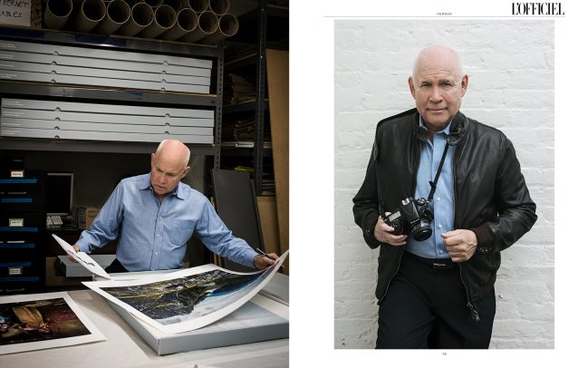 Steve McCurry with his camera posing for Officiel by Susi Belianska